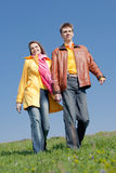 Attractive couple walking along the field Stock Photography