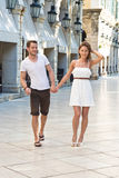 Attractive couple walking through the city on their summer holid Royalty Free Stock Photography