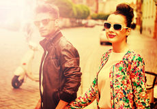 Attractive couple walking in  the downtown Stock Photography