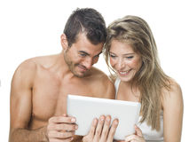 Attractive couple watching things in a tablet Stock Photography