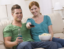 Attractive couple watching TV Stock Photography