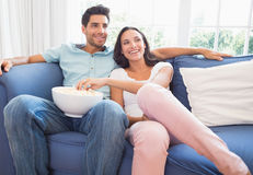 Attractive couple watching tv on the couch Stock Photo