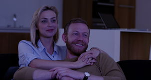 Attractive couple watching TV stock video footage