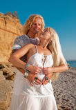 Attractive couple in white outdoors. Blond woman and man playing outdoors Stock Image