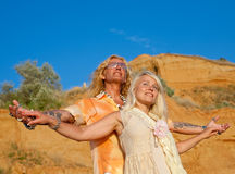 Attractive couple in white outdoors. Blond woman and man playing outdoors Royalty Free Stock Images