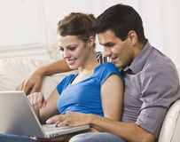 Attractive Couple Working on Laptop Together Royalty Free Stock Image