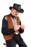 Attractive cowboy making cigar Stock Photos