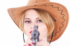 Attractive cowboy woman aiming a gun Stock Photo