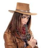 Attractive cowgirl with gun Royalty Free Stock Image