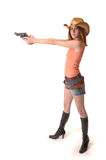 Attractive cowgirl with gun and boots Royalty Free Stock Photo