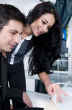 Attractive Coworkers finish a Project. Two attractive cowrkers in an Office. Shot with Hi Res Camera Royalty Free Stock Images