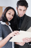 Attractive Coworkers finish a Project. Two attractive cowrkers in an Office. Shot with Hi Res Camera stock images