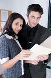 Attractive Coworkers working a the Office. Two attractive cowrkers in an Office. Shot with Hi Res Camera stock photo