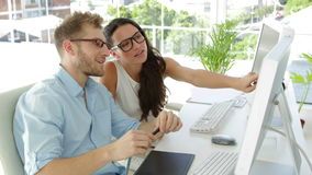 Attractive coworkers working together. In the office stock video footage