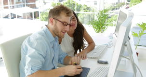 Attractive coworkers working together. In the office stock video