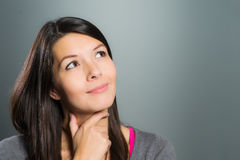 Attractive creative woman using her imagination Stock Photo