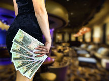 Attractive croupier. At the casino royalty free stock photography