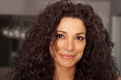 Attractive curly haired woman stock photos