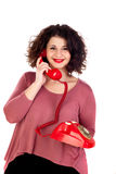 Attractive curvy girl calling with a red phone Stock Images