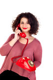 Attractive curvy girl calling with a red phone Stock Image