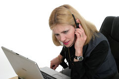 Attractive Customer Service Operator 2. Attractive and very attentive customer service operator representative working at a computer with telephone headset Royalty Free Stock Photography