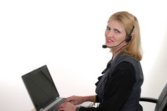 Attractive Customer Service Operator 4. Attractive, smiling, customer service operator representative working at a computer with telephone headset stock photos