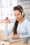 Attractive customer servicer working in office Royalty Free Stock Photography