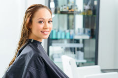 Attractive customer during special hair treatment Royalty Free Stock Photo