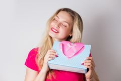 An attractive cute blonde woman received a gift for her birthday, Valentine`s day royalty free stock photo