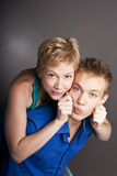 Attractive cute couple. Two in the studio Royalty Free Stock Images