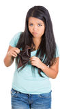 attractive cute young surprised, unhappy, puzzled woman, girl holding an empty wallet Stock Photography