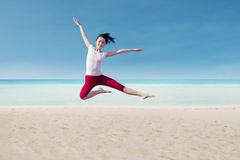 Attractive dancer jumping on beach Stock Image