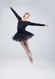 Attractive dancer jumping and practicing dance. Stock Image