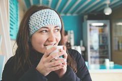 Girl drinks coffee. royalty free stock photography