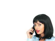 Attractive Dark Haired Young Woman Using a Mobile Cell or Chordless Telephone. Happy attractive Young Woman, with short black or dark hair, in her twenties Stock Images