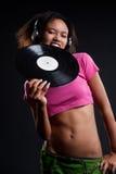 Attractive deejay in headphones biting vinyl royalty free stock photography