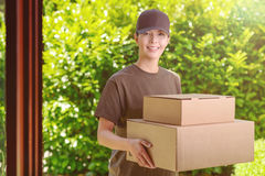 Attractive delivery woman with two cardboard boxes Stock Images