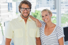 Attractive designer leaning on the colleagues shoulder Stock Image