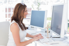 Attractive designer working at computer Stock Image