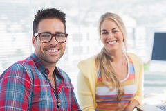Attractive designers sit in their office Stock Images