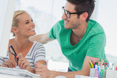 Attractive designers working in creative office Stock Photography