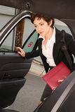 Attractive Determined Business Woman Traveler Enters Taxi Cab Stock Photography