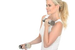 Attractive Determined Fit Healthy Young Blonde Woman Working Out with Dumb Bell Weights Stock Photo