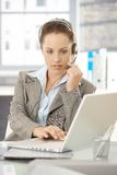 Attractive dispatcher working in bright office Royalty Free Stock Image