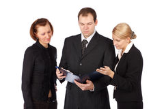 An attractive, diverse business team. Isolated over white background Stock Images