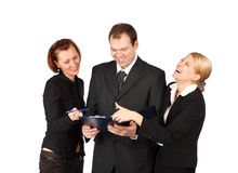 An attractive, diverse business team. Isolated over white background Stock Photos