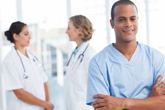Attractive doctor with arms folded Stock Photos