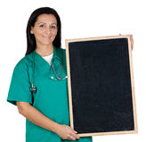 Attractive doctor with a blank slate Royalty Free Stock Image