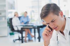 Attractive doctor calling Stock Photos