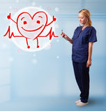Attractive doctor with happy red smiling heart Stock Image